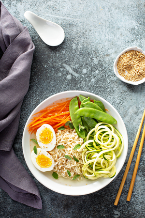 Bowl of noodles with egg and vegetables Stock Photo