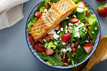 Fresh strawberries and goat cheese salad with salmon