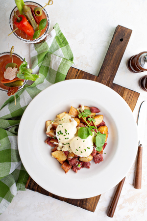Breakfast potatoes with eggs Benedict and beef