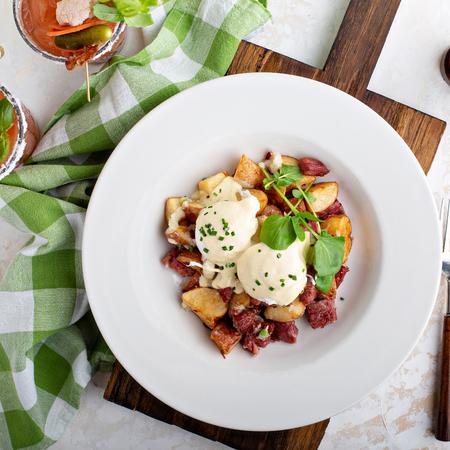 Breakfast potatoes with eggs Benedict and corned beef