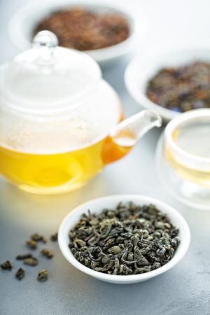 Green loose leaf tea and a teapot Stok Fotoğraf