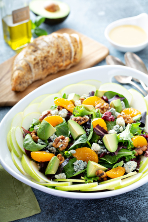 Fresh salad with blue cheese, walnuts, apples and mandarins