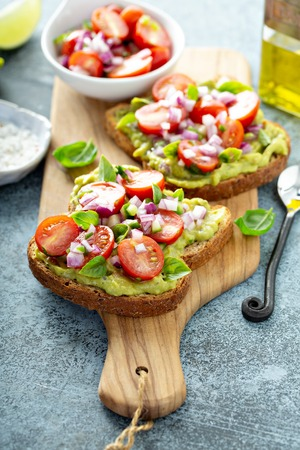 Fresh guacamole and tomato sandwich spread