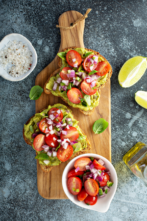 Fresh guacamole and tomato sandwich spread