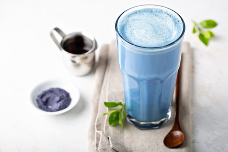 Blue matcha latte in tall glass