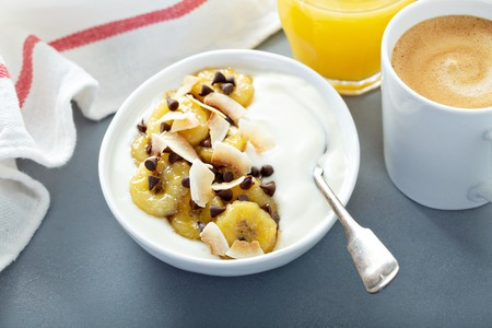 Plain yogurt with bananas, chocolate and coconut