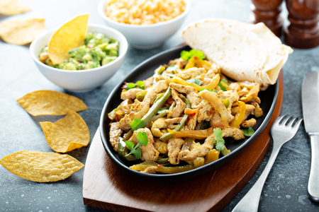 Chicken and bell peppers fajitas Stock Photo