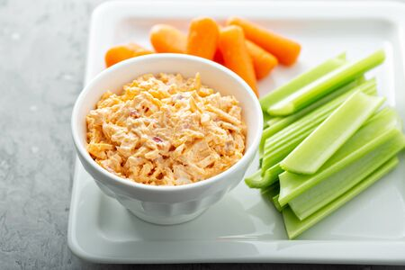 Pimento cheese with celery and carrot