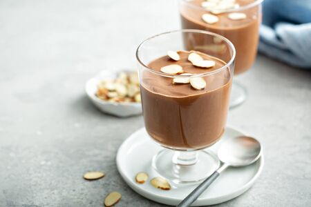 Chocolate pudding with sliced almonds