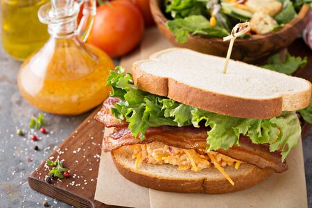 Pimento cheese, lettuce and bacon sandwich