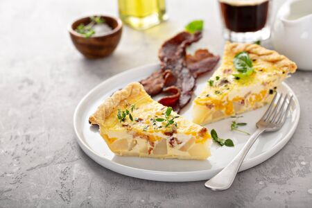 Breakfast plate with bacon and potato quiche