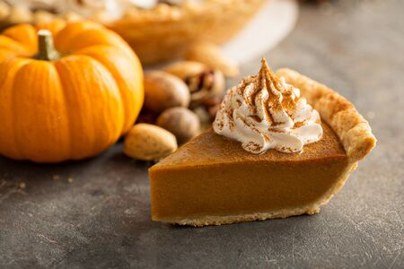 Traditional pumpkin pie with whipped cream