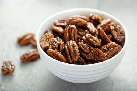 Caramelized or candied pecans Фото со стока