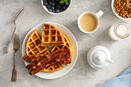 Breakfast plate with waffles and bacon