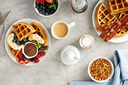 Breakfast table with waffles and granola Banco de Imagens
