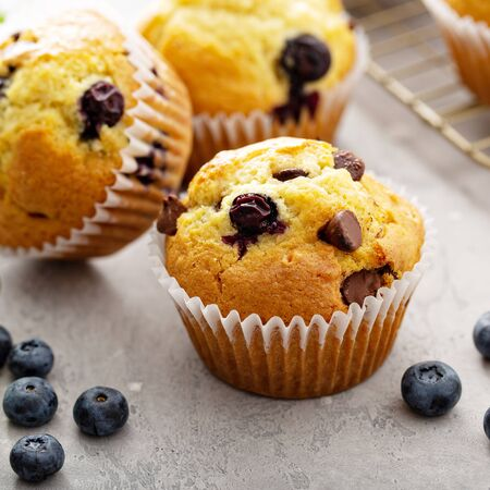 Chocolate chip and blueberry muffins with milk Banco de Imagens