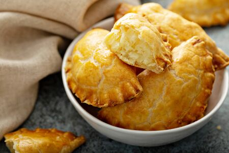 Hand pies with potato filling Stock Photo