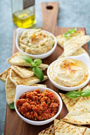 Mediterranean mezze board with pita and spicy tomato dip