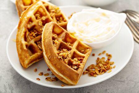 Breakfast waffles with honey, yogurt and granola
