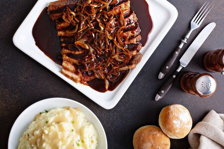 Holiday table brisket with caramelized onions Stock Photo