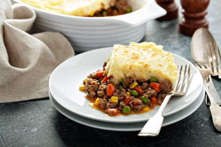 Shepherds pie with ground beef and vegetables portion on a plate