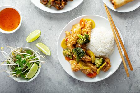 Orange chicken with vegetables and rice
