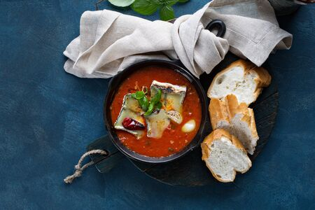 Baked cheese and garlic in tomato sauce Stock Photo