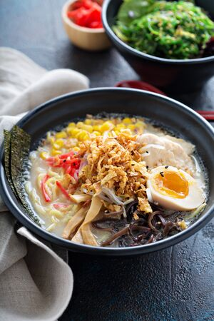 Ramen bowl with pork and corn and seaweed
