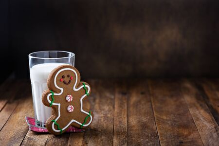 Gingerbread man cookie with a glass of milk