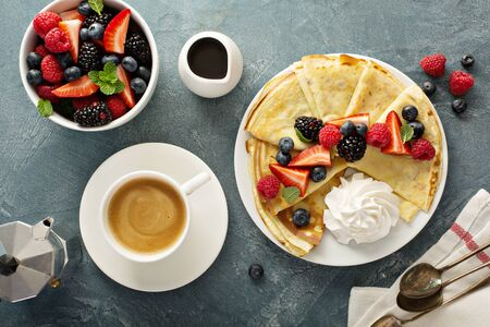Thin crepes with berries Stock Photo