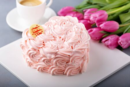 Valentines Day cake topped with cream roses