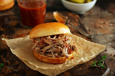 Pulled pork sandwich with brioche buns and pickles Stock fotó