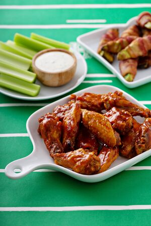 Hot wings glazed with honey, air fried or roasted, game day food 스톡 콘텐츠 - 140993145