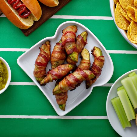 Bacon wrapped avocado, game day appetizer, super bowl food 스톡 콘텐츠 - 140993463