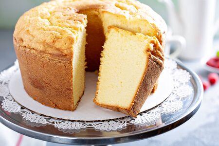 Pound cake or angel food cake sliced on a cake stand