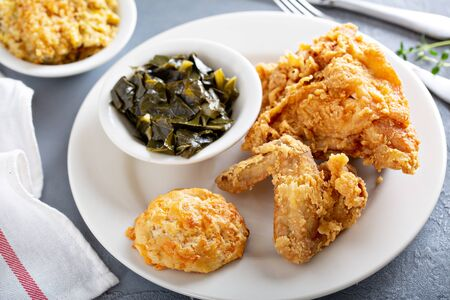 Southern fried chicken with collard greens, mac and cheese and biscuit