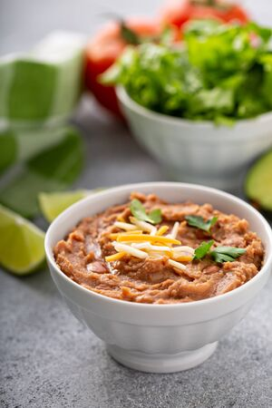 Refried beans in a white bowl, mexican dish