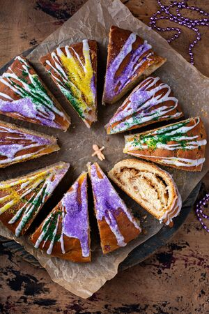 King cake for Mardi Gras, New Orlean traditional pastry with a plastic baby