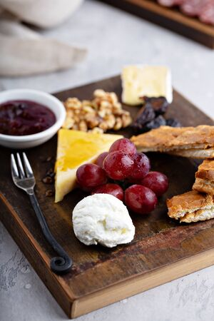 Cheese snack plate with nuts and grapes