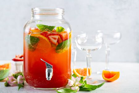 Strawberry, orange and basil sparkling punch, spring cocktail