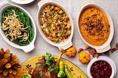 Traditional Thanksgiving sides, green beans casserole, stuffing and sweet potatoes Reklamní fotografie