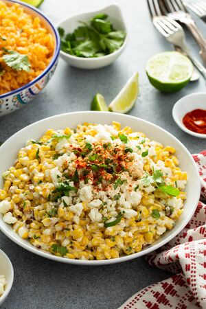 Mexican street corn, elote with cotija cheese, fresh cilantro and chili