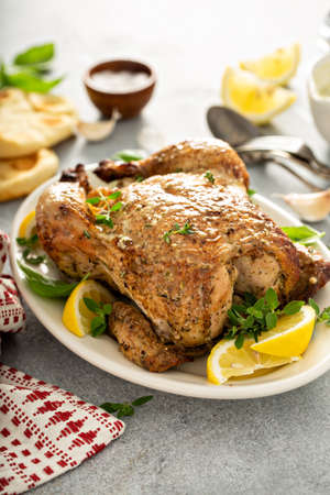 Whole lemon herbs and garlic roasted chicken