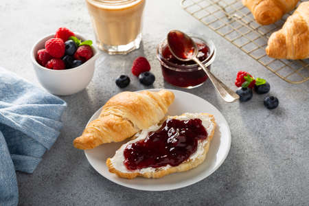 Fresh summer breakfast with croissants and berry jam