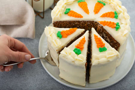 Carrot cake with cream cheese frosting cut into slices