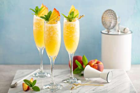 Peach mimosas cocktail for brunch Stok Fotoğraf