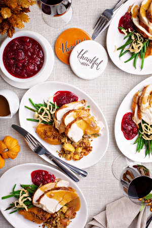 Traditional Thanksgiving plates with turkey and sides