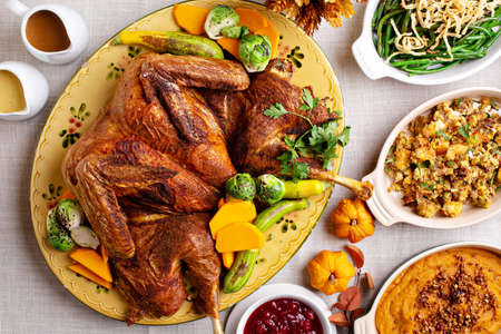 Traditional Thanksgiving table with turkey and sides