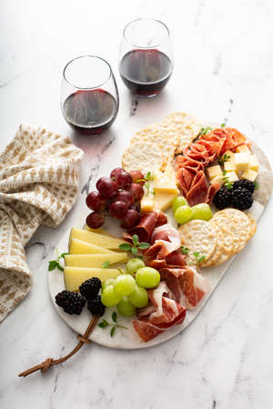 Charcuterie board with cheese and meat