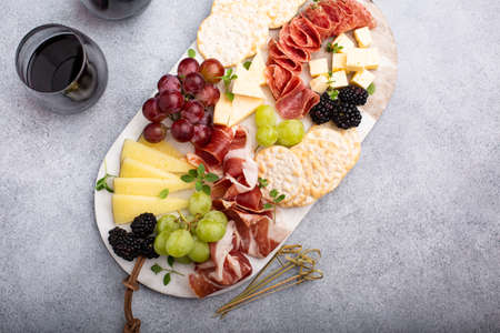 Cheese or snack board with meat and fruit